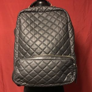 Nila Anthony quilted backpack with gold hardware.